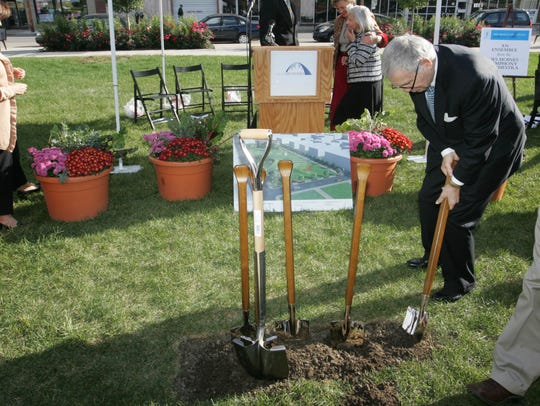 John Pappajohn stabilizes his shovel after the groundbreaking