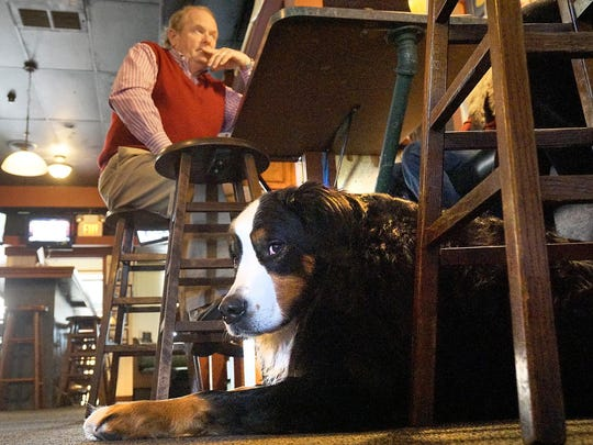 Stella keeps an eye on the place, while staying close to owner Bob Ostendorf.