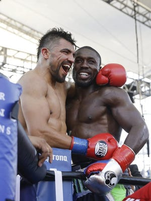 Andre Berto (right) is congratulated by Victor Ortiz after beating Ortiz by knockout in the fourth round of their fight on April 30, 2016. Ortiz, a Ventura resident, will return to the ring July 30.