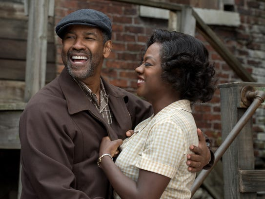 Denzel Washington plays Troy Maxson and Viola Davis