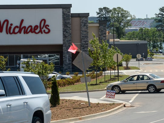 Cars drive to and from the Hartwell Village shopping center near Clemson on Wednesday. The 350,000 square foot space on 45 acres is at the corner of U.S. 76 and State Highway 93, is in Oconee County, bordering with Pickens County in view of Memorial Stadium and next door to Newspring Church.