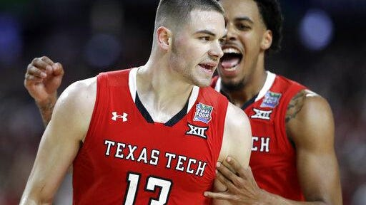 Texas Tech guard Matt Mooney (13) celebrates after making a three-point basket during the second half against Michigan State in the semifinals of the Final Four NCAA college basketball tournament on April 6, 2019, in Minneapolis. Mooney, who was scheduled to hold a two-day basketball camp this week, postponed those plans due to new coronavirus protocols set last week.