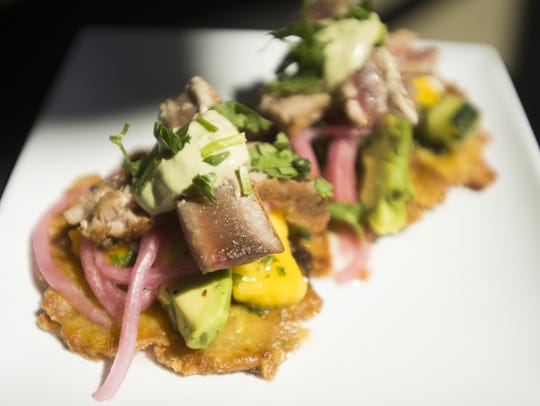 Ahi tuna is served with mango and avocado on plantain