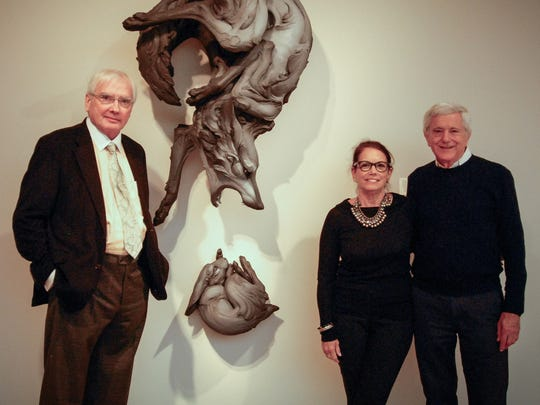 Stephen and Pamela Hootkin (right) are seen with Chazen Museum of Art Director Russell Panczenko (left) in the Chazen's fourth floor gallery that bears their name.