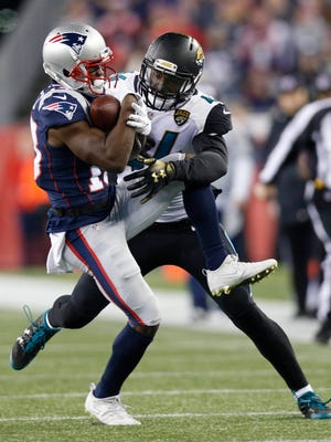 New England Patriots wide receiver Phillip Dorsett (13) makes a catch as Jacksonville Jaguars outside linebacker Myles Jack (44) defends during the fourth quarter in the AFC Championship Game at Gillette Stadium.