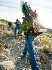 Joe Franco, of Las Cruces, carries the Virgin of Guadalupe