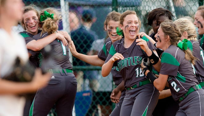 Brantley's Lainey Wells (2) and Brantley's Anna Katherine Kimbro (16) celebrate winning the AHSAA Class 1A State Tournament after winning the title game 10-0 in five innings against Isabella on Friday, May 15, 2015, at Lagoon Park in Montgomery, Ala.