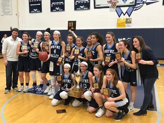 The Wayne Valley girls basketball team celebrates winning