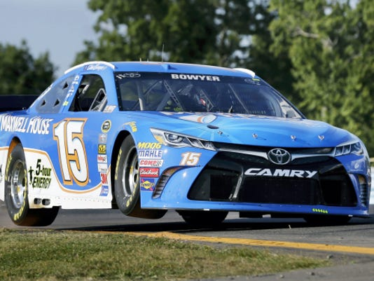 Clint Bowyer hits curbing as he drives during practice for today's NASCAR Sprint Cup race at Watkins Glen International on Friday.