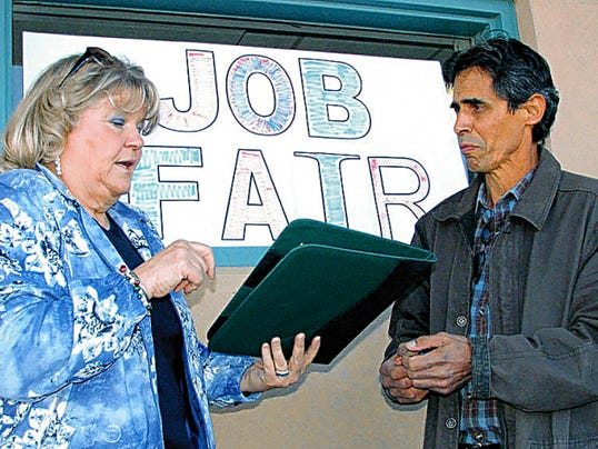 Headlight File Photo   Luna County Commissioner Linda Smrkovsky and Roberto Montoya of New Mexico Workforce Connection in Deming, discuss plans for the Deming Career Expo to be held Thursday, June 4, at the Special Events Center.