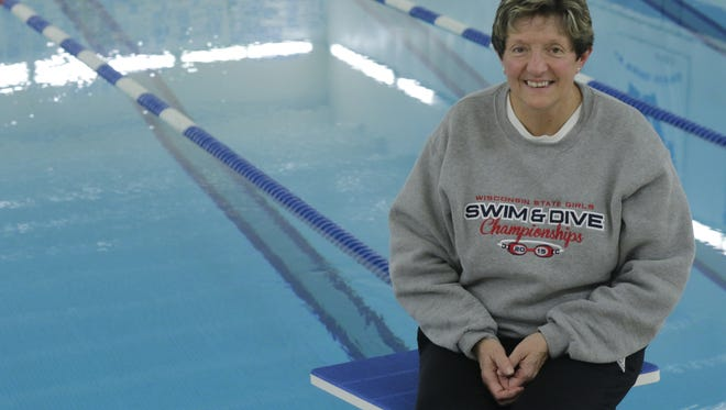 Carrie Bores, who retired this fall after 34 season of being a part of the Oshkosh West swimming program, was a one-person swimming team for Southern Door High School in the mid-1970s.