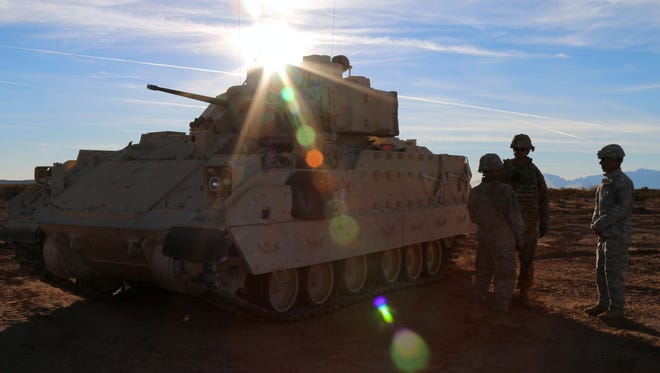 Soldiers from 4th Battalion, 6th Infantry Regiment, 3rd Armored Brigade Combat Team, 1st Armored Division, discuss exercise objectives during Bulldog Focus at McGregor Range, New Mexico, Jan. 21, 2016.
