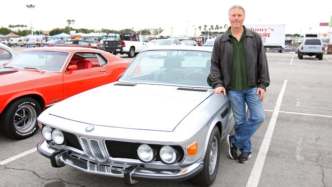 Bob Klemme and his 1971 BMW 2800 CS at the Cars and Coffee car gathering in Costa Mesa, Calif.