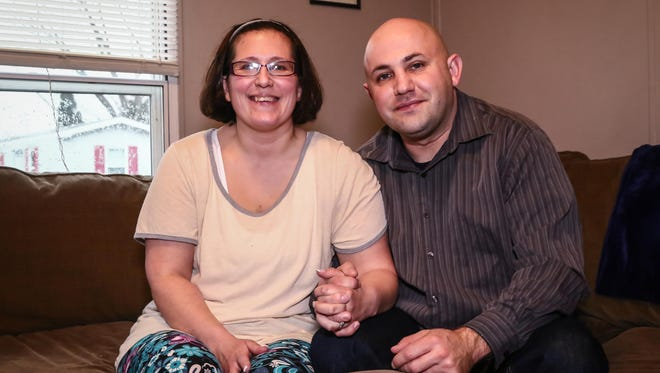Laura and David DeMusz, high school sweethearts pose for a photo Sunday. Feb. 12, 2017, at the DeMusz home in Middletown.