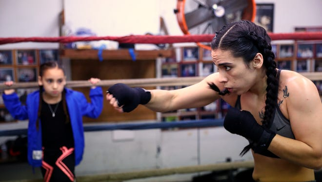 Felycia Luna, 26, works out Wednesday, Feb. 21, 2018, at the Corpus Christi Police Officers Association Boxing Club, while her daughter Audrey Rivas, 8, watches. Luna is the first woman boxer from the Coastal Bend to compete in the Texas State Golden Gloves competition, scheduled Feb. 28.