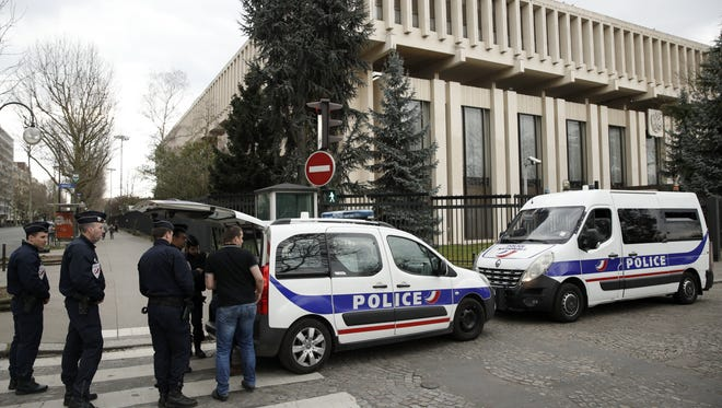 Police officers gather outside the Russian Embassy in Paris on March 26, 2018, after France announced it will expel four Russian diplomats.