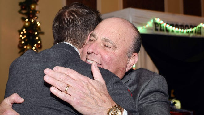Dutchess County Regional Chamber of Commerce President Charles North gets at his retirement party from Bill Lessner of Adams Fairacre Farms on Thursday at The Grandview in the City of Poughkeepsie.