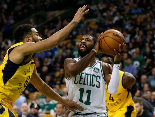 Celtics guard Kyrie Irving (11) is guarded by Indiana