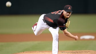 Arizona Diamondbacks starting pitcher Shelby Miller (26) pitches during the first inning of a game against the Los Angeles Dodgers at Chase Field last season.