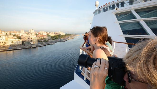 Passengers line the decks of the Norwegian Sky as it pulls into Havana, Cuba on May 2, 2017.