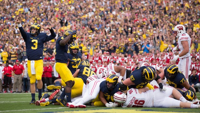Wolverines QB Wilton Speight celebrates a TD by Khalid Hill against Wisconsin at Michigan Stadium on Oct. 1, 2016 in Ann Arbor.
