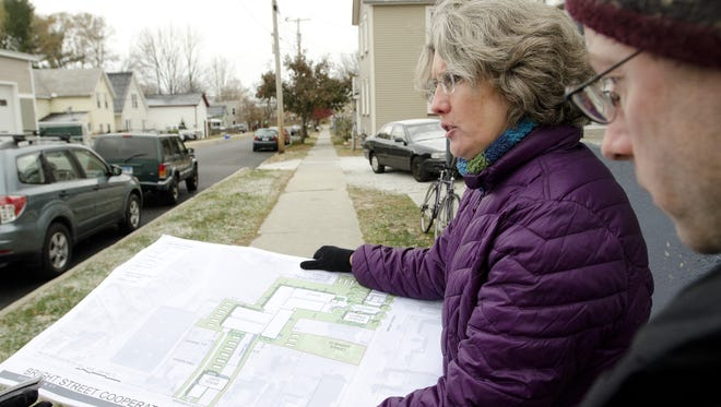 Chris Donnelly (right) and Amy Demetrowitz of Champlain Housing Trust tour Bright Street in Burlington's Old North End as they announce in 2013 a new co-op housing development project that will add 35 units of apartment housing, plus a trinity, a duplex and a gate house to the neighborhood.