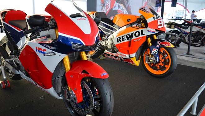 Honda's RC213V-S, left, is the street-legal version of its MotoGP bike, right.