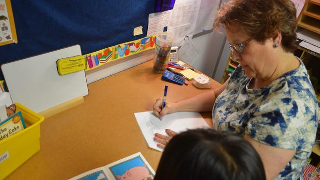 First-grade reading teacher Liane Christensen works one-on-one with a student. Christensen is the last remaining teacher in Winner Elementary School's Reading Recovery program.