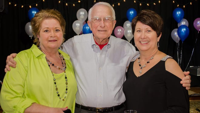 Clinton Carter, center, enjoyed his recent surprise birthday celebration with his daughters, Julie Carey, left, and Amy Reid, right, both from Winston-Salem, N.C.