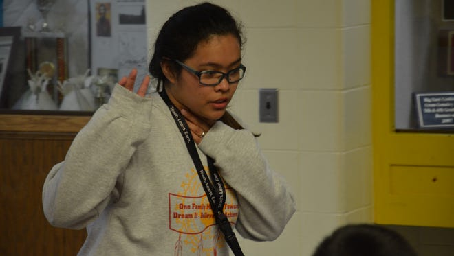 First-grade teacher Danna Endozo helps her students get settled during lunch. Endozo, a native Filipino, works at St. Francis Indian School on the Rosebud Reservation.