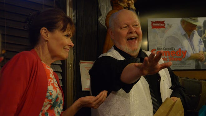 Paula Alexander participates in one of magician Ron Carnell's routines in August at Colon's River Lake Inn.
