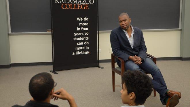 Renowned writer Ta-Nehisi Coates talks with Kalamazoo-area students before his keynote address at the Miller Auditorium at Western Michigan University.