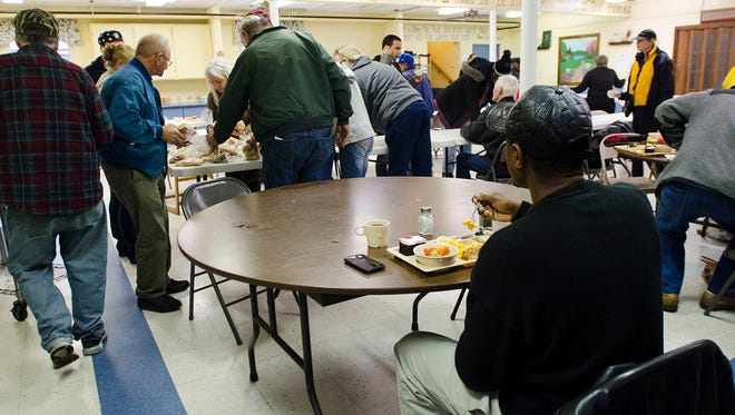 Jimmie Jenkins eats lunch by himself at Mid-City Nutrition Thursday afternoon.