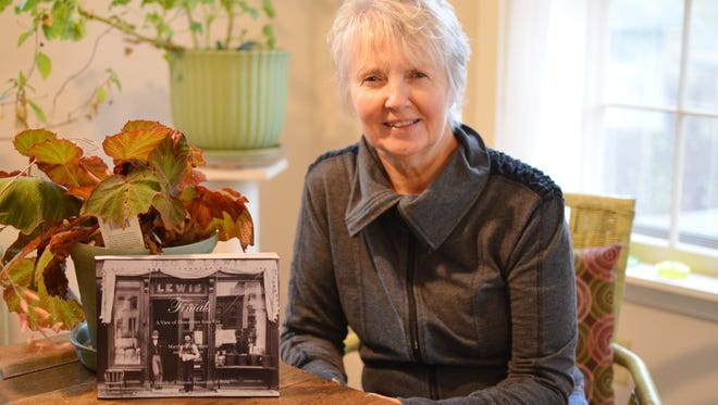 """Author Marybeth Slonneger has compiled a new book of essays and photographs titled """"Finials: A View of Downtown Iowa City."""""""