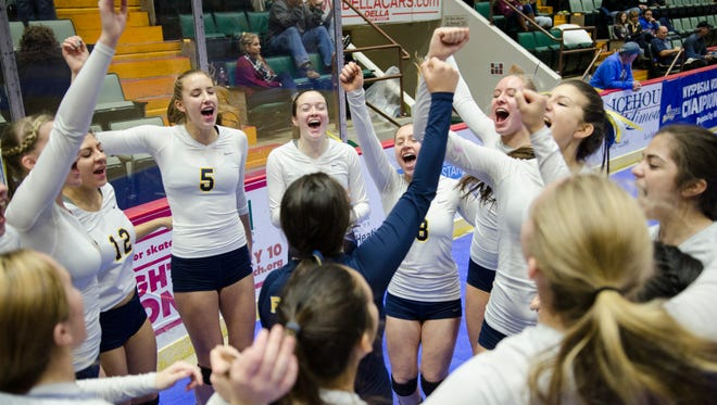 Players of Walter Panas get pumped up before their match against Burnt Hills-Ballston Lake in the Class A State Volleyball Finals at the Glens Falls Civic Center on Sunday November 22, 2015.