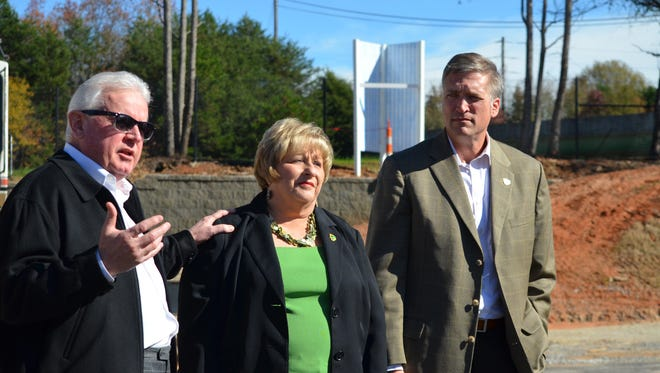 Gregory Pest Solutions owners Phil and Sara Gregory, along with company president Ben Walker, speak at the construction site of the company's new corporate headquarters in Greenville.