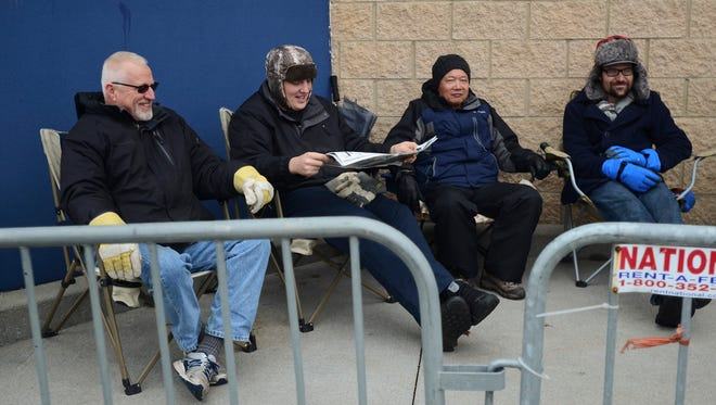 Customers wait outside of Best Buy in Fort Gratiot Thursday afternoon to be the first in line to shop when the doors open at 5 p.m. Thursday.