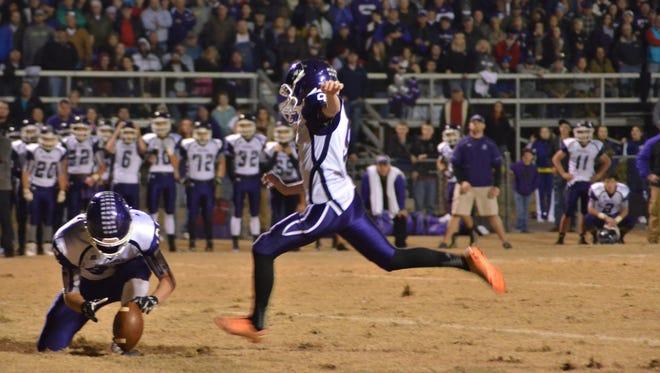 Mitchell's Ben Bonner kicks the winning field goal on Friday.