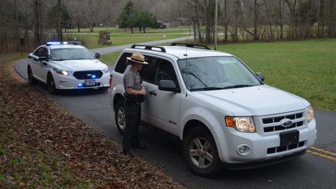 Visitor and resource protection ranger Carmen Barnard makes a traffic stop in the Oconaluftee area of Great Smoky Mountains National Park, where she has worked for more than six years.