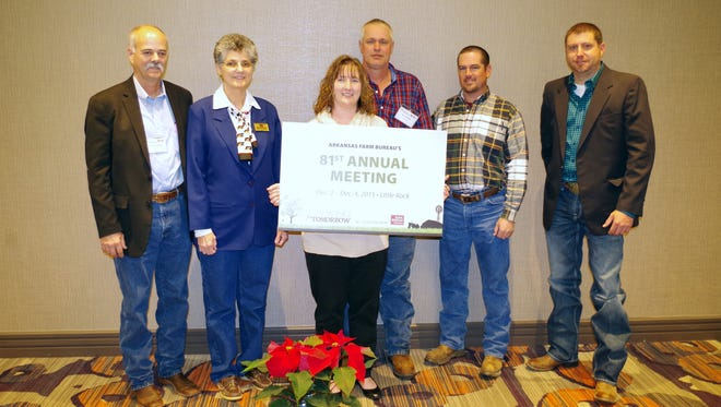 Baxter County Farm Bureau members, from left, Elliott Golmon, county president; his wife, Roberta Golmon; Rebekkah Crawford, Mel Crawford, Robert Benedict and Josh Baker were among 1,026 who attended Arkansas Farm Bureau's state convention Dec. 2-4 in Little Rock. During the three-day meeting, activities included addresses by Gov. Asa Hutchinson and Arkansas Farm Bureau President Randy Veach. Counties were honored for their accomplishments for the past year. Delegates voted on formal recommendations submitted by counties for inclusion in the organization's policy.