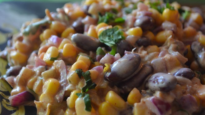 This Mexican Inspired Corn and Bean Dip is scrumptious and perfect for watching the play-offs. It's very popular at parties, quick and easy to make, and loaded with flavor.