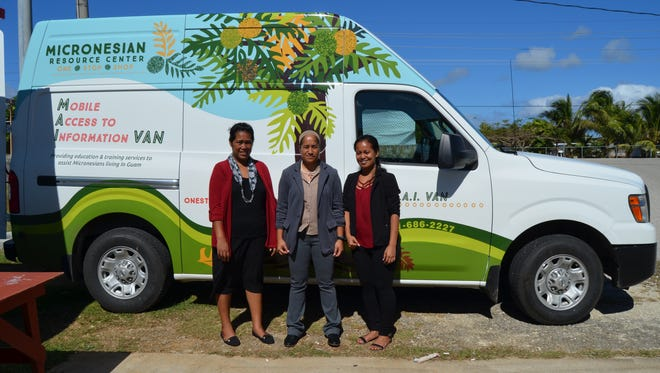 Micronesian Resource Center One Stop Shop staff from left  Aileen Namelo,caseworker, Sylvia Elias, project director, and Sanolyn Rettin, case worker, pose in front of the center's Mobile Access to Information Van. The van has been operational since October.