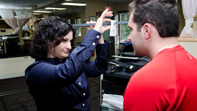 Concussion expert Dr. Arlene Goodman examining a patient at the Sports Medicine Institute.