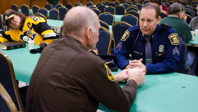 St. Clair County Cpt. Ron Muxlow and Michigan State Police Sgt. Todd Leveille talk during the Second Annual Law Enforcement Spaghetti Dinner at the American Legion Post 8 in Port Huron.