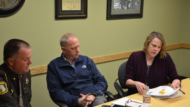From left, Calhoun County Sheriff Matt Saxton, Health Officer Jim Rutherford and Substance Abuse Council Executive Director Dawn Smith looked over drug use information Tuesday.