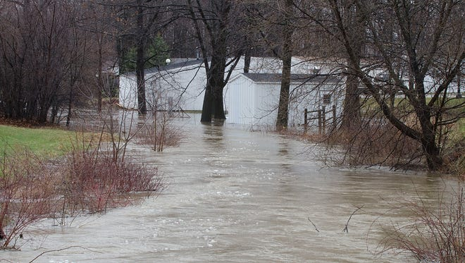 Bunce Creek over flows its banks in Marysville Villa Estates off Ravenswood Road.