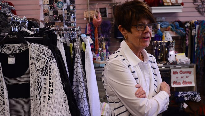 Suzanne Kuhn is moving her women's clothing store to downtown Port Huron.