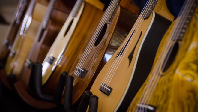 Ukuleles are lined up at the Reno Ukulele Festival, which actually takes place in Sparks. The Eighth Annual Reno Ukulele Festival begins Thursday.
