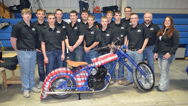 The 2015 team from Mishicot High School poses next to its mini-chopper. The team was sponsored by Manitowoc Cranes.