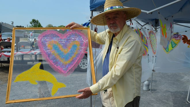 Harry Franzen of Millville is pictured with one of his window cling art pieces at the grand opening of the Maurice River Township Veterans' Flea Market last May. The flea market is located on Roue 47 in Dorchester near the Mauricetown Causeway. Photo/Jodi Streahle